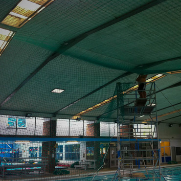 Fall arrest nets to enable re roofing of swimming pool to be carried out